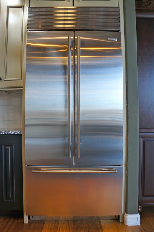 The refrigerator is available in a Stainless Steel finish or it can be fitted with a custom panel overlay.